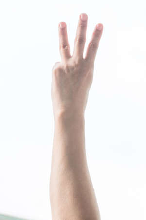 Hand up with 3 three fingers with rim light isolated on white background (clipping path)