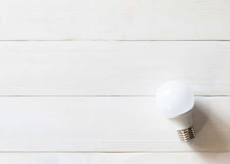 LED light-emitting diode lightbulb for lamp on clean bright white natural wood texture background