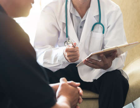 Mens health exam with doctor or psychiatrist working with patient having consultation on diagnostic examination on male disease or mental illness in medical clinic or hospital mental health service