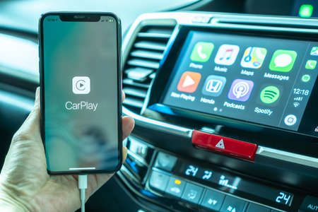 BANGKOK, THAILAND-16 May, 2019: Apple CarPlay app on iPhone X, smart mobile application connected to Honda car for travel map, hand free phone call, online music on transportation vehicle safety Editorial