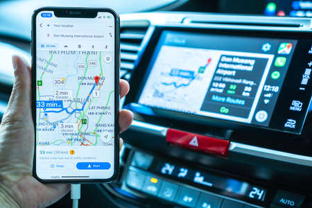 BANGKOK, THAILAND-16 May, 2019: Google map on Apple CarPlay app on iPhone X smart mobile application connected to Honda car for online gps road travel map, transportation vehicle safety