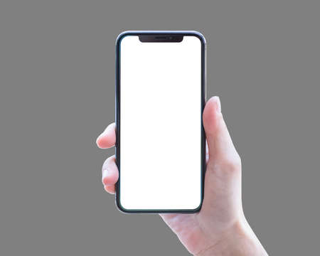 Smartphone in woman's hand isolated on grey background with blank white screen (clipping path)  for digital mobile smart phone mockup and template