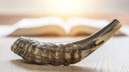 Yom Kippur and Rosh Hashanah (Hashana)  (jewish New Year holiday) concept with Ram shofar (horn) with religious holy prayer book on table Zdjęcie Seryjne