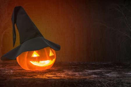 Halloween pumpkin Jack OLantern smiling face on grunge wood background