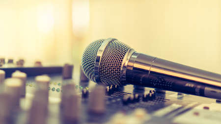 Microphone voice speaker on karaoke or audio synthesiser electronic music instrument sound mixer in radio broadcasting studio room, seminar event, show or wedding party Stok Fotoğraf