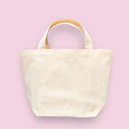 Tote bag canvas white cotton fabric cloth for eco shoulder shopping sack mockup blank template isolated on pastel pink background (clipping path) Stok Fotoğraf