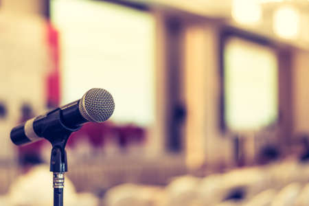 Microphone voice speaker in business seminar, speech presentation, town hall meeting, lecture hall or conference room in corporate or community event for host or townhall public hearing Stok Fotoğraf