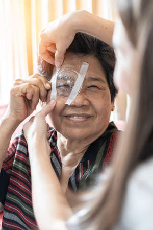 Elderly patient woman having eye care treatment on Age-related eye diseases, AMD, Diabetic retinopathy, Glaucoma, low vision, dry eyes    Stok Fotoğraf