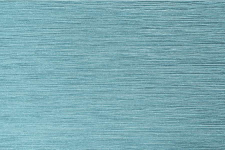 Metallic glazed tile texture background in cyan teal green blue mint color