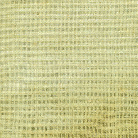 Hessian sack cloth texture canvas fabric pattern background in light lime yellow green color 版權商用圖片