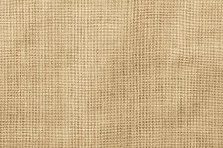 Hessian sackcloth woven texture pattern background in light yellow gold cream color 版權商用圖片