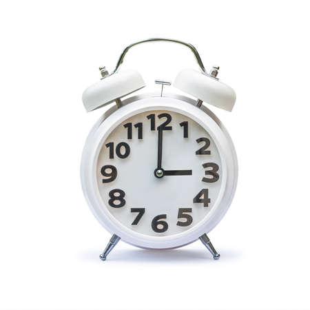 White alarm clock at 3 three oclock isolated on white background.