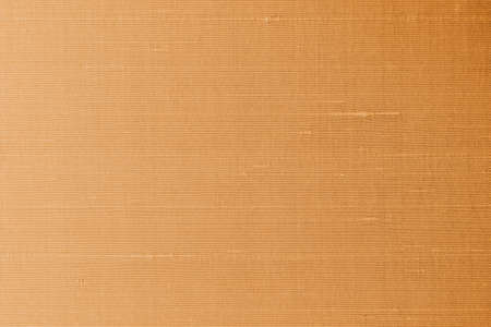 Copper gold silk fabric background of satin texture cotton cloth pattern with shiny gradient silky woven detail