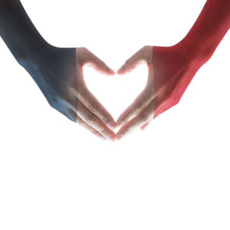 France national flag pattern on peoples hands in heart shape on white background (isolated with clipping path) Stock fotó