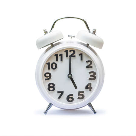 White alarm clock at 5 five o'clock isolated on white background (clipping path)