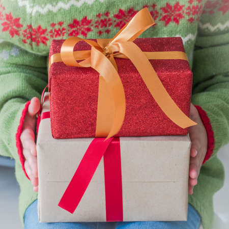 Gift box in childs hands for Happy new year & Merry Christmas, Xmas boxing day and Saint Nicholas day holiday seasonal celebration