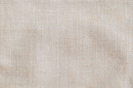 Hessian sackcloth woven fabric texture background in beige cream color