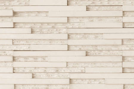 Granite tiled wall detailed pattern texture background in natural light creme beige color Stock Photo