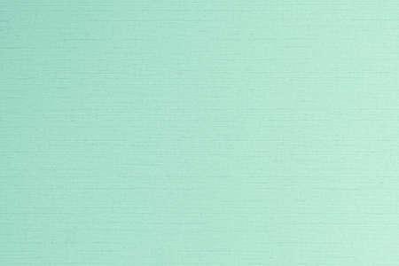 Cotton linen fabric textile woven textured backdrop in pastel light green blue mint color