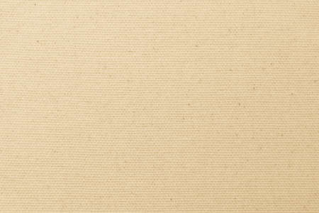 Hessian sackcloth woven texture pattern background in light yellow cream brown