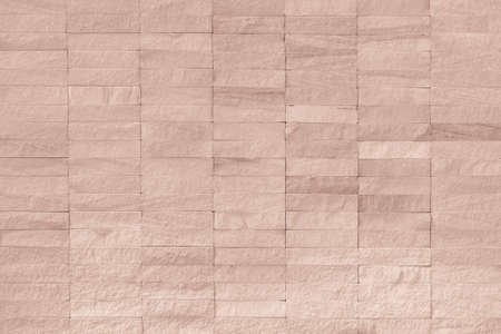 Rock tile wall texture background in light red brown