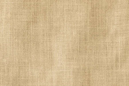 Hessian sackcloth woven texture pattern background in light cream yellow beige earth tone color