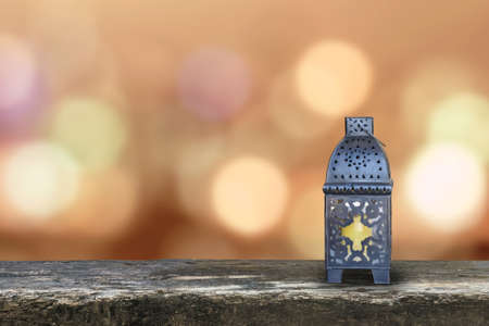 Ramadan Kareem background with Eid lamp or Arabic lantern on gold candle light bokeh for Islamic muslims religious fasting month Stock Photo