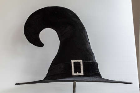 Halloween Witch wizard's hat in black isolated on white background with clipping path for Autumn seasonal holiday costume