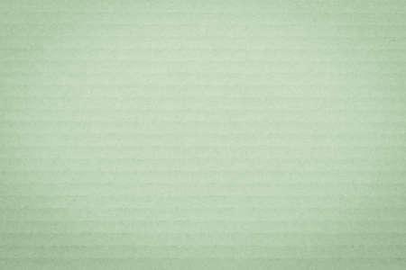 Vintage green color corrugated cardboard paper texture patterned background