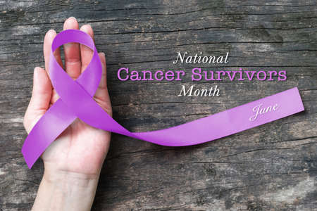 National cancer survivors month of June campaign by Lavender purple symbolic color ribbon Standard-Bild