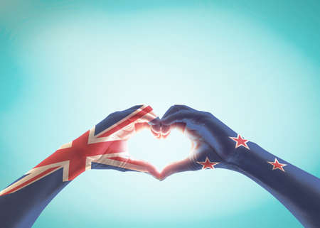 New Zealand flag pattern on people hands in heart shape for NZ national public holiday celebration Stock Photo