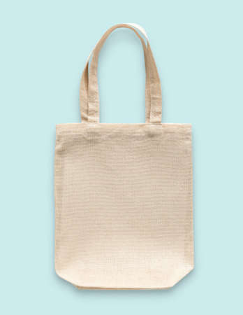 Tote bag canvas cotton fabric cloth for eco shopping sack mockup blank template isolated on blue background