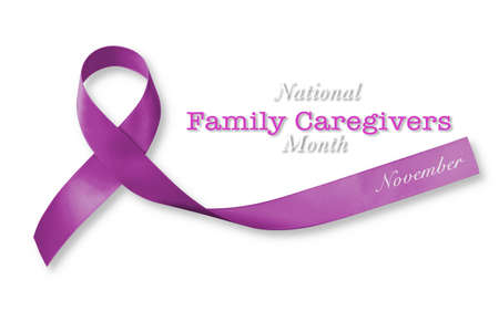 National family caregivers month in November with plum purple ribbon awareness Archivio Fotografico