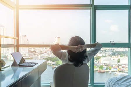 Work-life balance relaxation with Asian working business woman healthy lifestyle take it easy resting in comfort hotel or home living room having free time with peace of mind and self health balance
