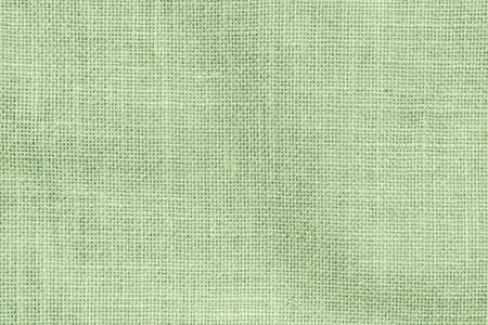 Hessische zak geweven textuur patroon achtergrond in licht bleke groene aarde kleur