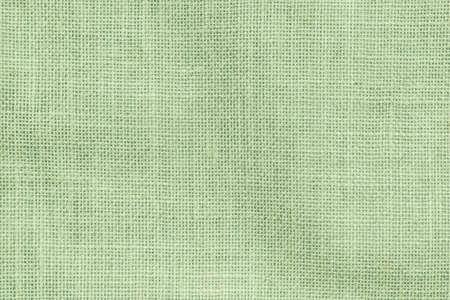Hessischer Sackleinen gewebter Texturmusterhintergrund in heller hellgrüner Erdfarbe
