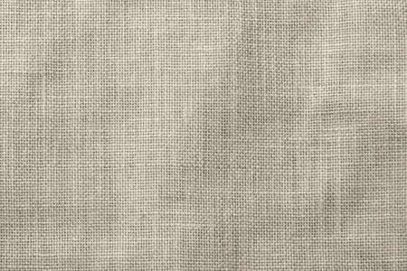Hessian sackcloth woven texture pattern background in light sepia tan brown color tone