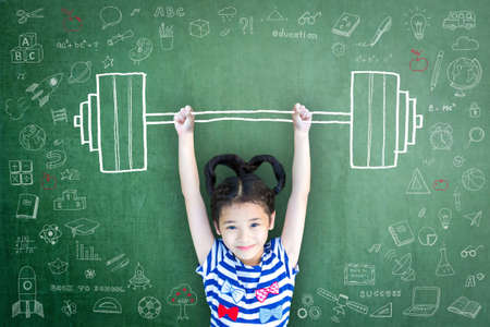 Strong kid with weight lifting doodle on chalkboard for equal opportunity awareness on gender and children rights concept Standard-Bild