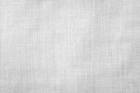 White burlap fabric sackcloth texture background white grey color