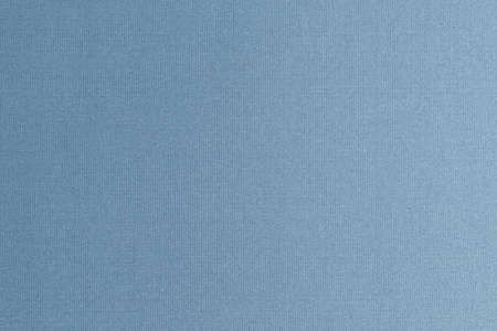 Fine authentic silk fabric texture pattern background in shiny dark blue silver grey color