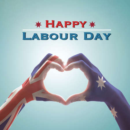 Happy labour day with Australia flag pattern on people hands in heart shape 版權商用圖片