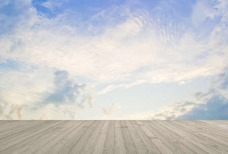 Wooden floor in sepa brown with blur nature background of blue sky and clouds