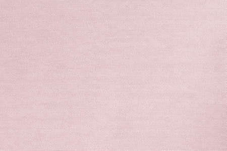 Woven cotton fabrics textile textured background in light pastel pale sweet pink color tone