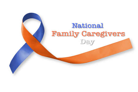 National family caregivers awareness in orange navy blue color fabric ribbon isolated on white background (clipping path) Standard-Bild
