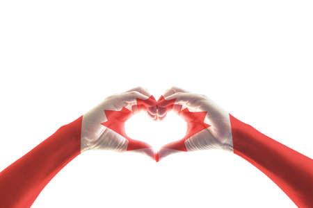 Canada flag pattern on people hands in heart shape for national public holiday celebration concept