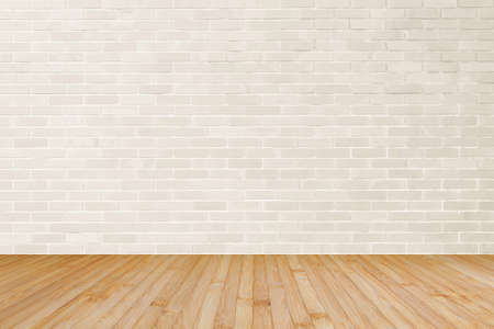 Cream brown brick wall textured background with wooden floor in yellow brown for interiors Stock fotó