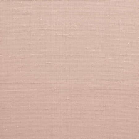 Fijne natuurlijke katoenen zijde stof textuur achtergrond in licht rood oranje bruine kleurtoon