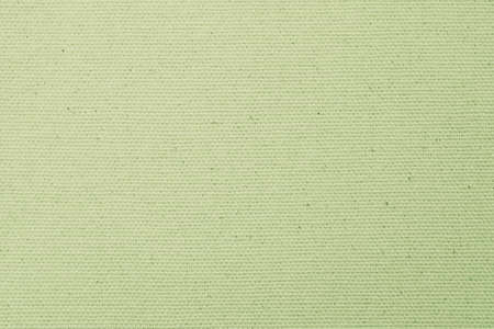 Hessian sackcloth woven texture pattern background in pale green lime yellow earth tone color