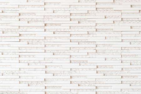 Mur carrelé de granit motif détaillé texture de fond dans la couleur beige crème de lumière naturelle