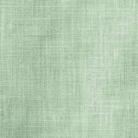 Hessian sackcloth woven texture pattern background in light pale green earth color